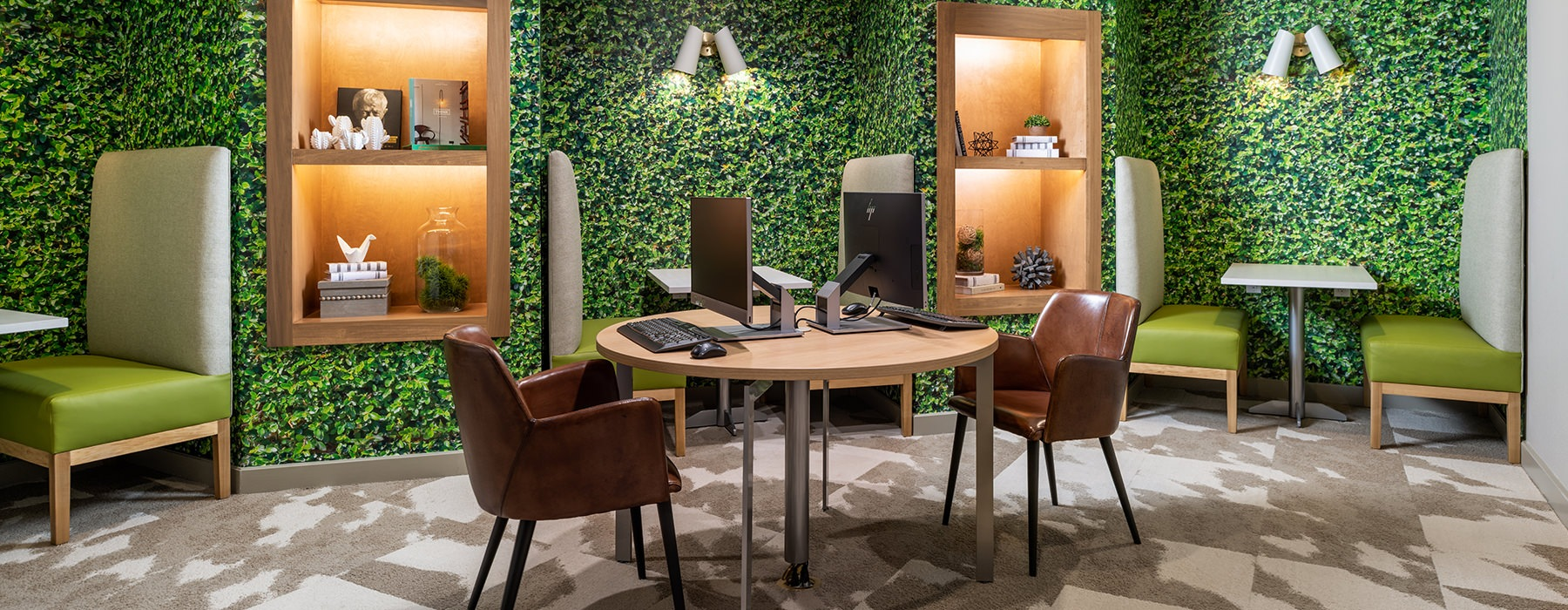 Spacious and well lit business center with floral wall accents